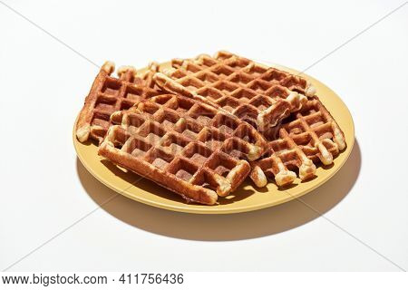 Eat Me. Freshly Baked Belgian Waffles With Sugar On Yellow Plate Isolated Over Light Background, Tra