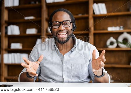 Video Conference With A Cheerful Male Colleague, Headshot Of Smiling African Man Wearing Headset, Ta