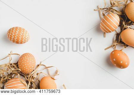 Happy Easter Concept. Frame Of Elegant Easter Eggs On White Background. Flat Lay, Top View, Copy Spa