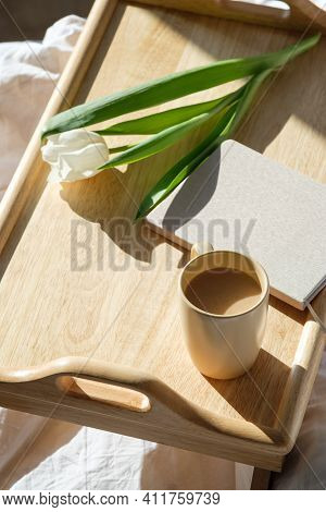 Wooden Breakfast Tray With Cup Of Coffee, Tulip Flowers, Diary On Bed. Romantic, Love Concept.