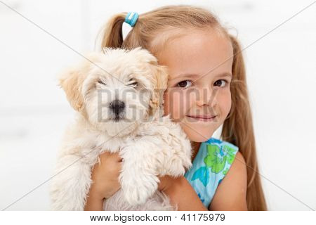 Little girl loves her fluffy dog posing together for the camera poster