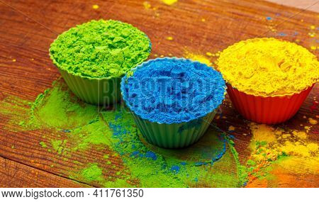 Colorful traditional holi powder in bowls. Happy holi. Concept Indian color festival called Holi. Organic Gulal dust