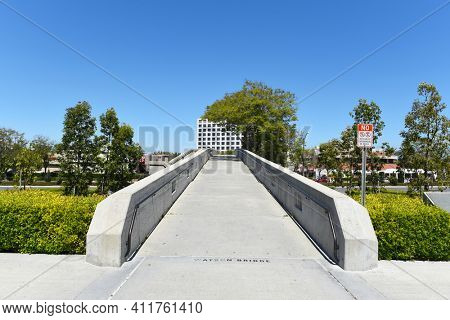 IRVINE, CALIFORNIA - 16 APRIL 2020: Watson Bridge looking from  the University of California Irvine, UCI towards University Center shopping area.