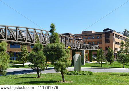 IRVINE, CALIFORNIA - 16 APRIL 2020: Pedestrian Bridge near the Claire Trevor School of the Arts on the University of California Irvine, UCI campus.