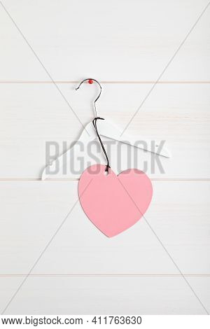White Rack With Heart Tag. Slow Fashion, Circular Economy, Eco Friendly Sustainable Shopping, Thrift