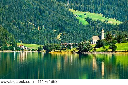 Church In Reschen Am See Or Resia, A Village On Lake Reschen In South Tyrol, Italian Alps