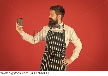 Brutal Coffee Maker. Portrait Of Bearded Barista Standing In Cafe. Barista Handsome Worker. Friendly