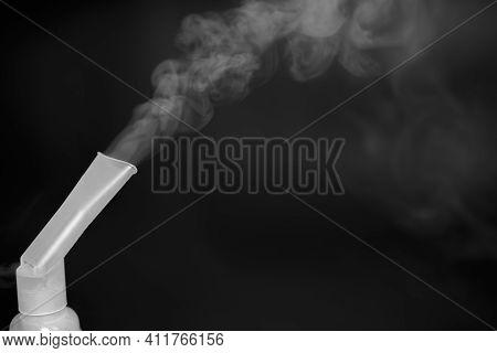 Equipment For Inhalation. Compressor Nebulizer On A Black Background. Respiratory Medicine. Respirat