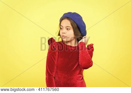 Parisian Kid In French Beret Hat And Elegant Red Dress On Yellow Background, Retro Fashion.