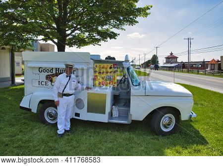 Old Restored Good Humor Ice Cream Truck And Owner Parked On Grass Selling Ice Cream
