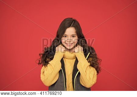 Super Warm And Fashionable. Fashionable Look Of Small Child. Happy Girl In Fashionable Style Red Bac