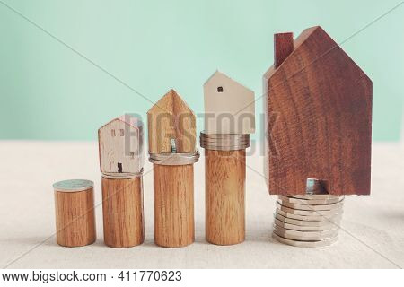 Wooden Houses And Money Coins On Stacking Woods, Housing Boom, Property Investment Market Growing, H
