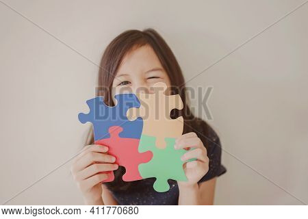 Young Girl Holding Puzzle Jigsaw,  Child Mental Health Concept, World Autism Awareness Day, Autism S