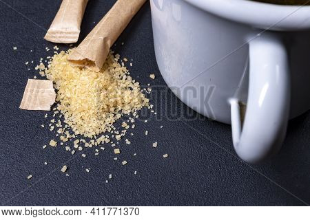 Spilled Cane Sugar From A Paper Bag. Sweetening Tea With Sugar.