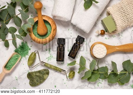 Natural Skin Care And Aromatherapy With Eucalyptus Essential Oil Bottles, Bath Salt, Beauty Jade Rol