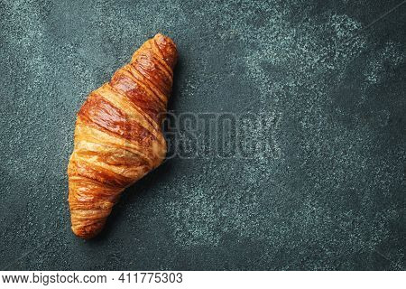 Fresh Sweet Croissant With Butter For Breakfast. Continental Breakfast On A Dark Concrete Table. Top
