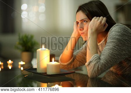 Angry Homeowner Using Candles During Power Outage In The Night At Home