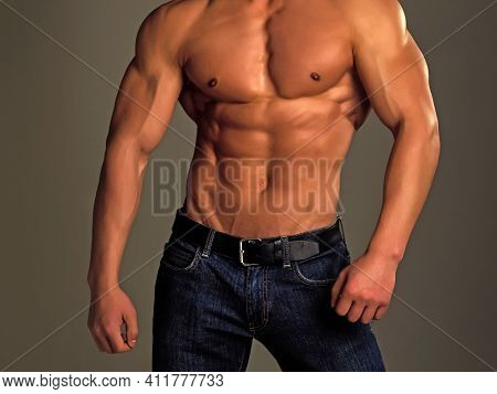 Mens Heals Body Care. Athletic Bodybuilder Man On Grey Background. Muscular Man With Sexy Nude Body