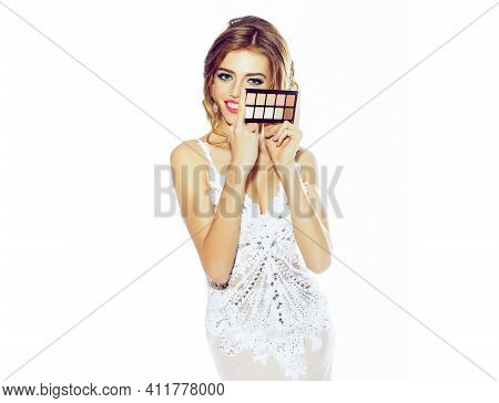 Make Up Palette. Young Woman In Elegant Dress Holding Makeup Palette With Tone Foundation. Makeup Ar