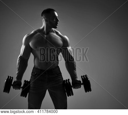 Portrait Of A Muscular Strong Well Built Men Bodybuilder Holding, Lifting Dumbbells Weights, Getting