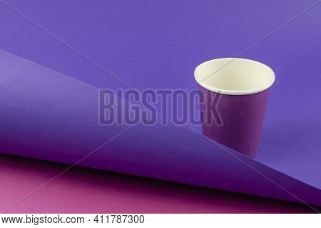 Lilac Paper Cup On A Two-color Abstract Geometric Background. Empty Glass For Drinks On A Purple-pin