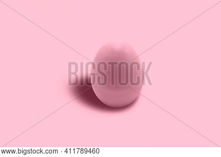 A Chicken Egg Painted Pink In Close-up On A Pink Background. Free Space. Minimalism. Pink On Pink