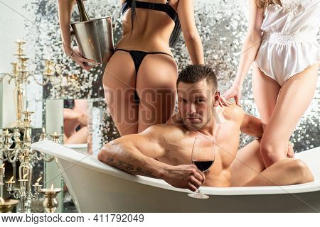 Threesome Concept. Three People Having Group Sex. Man With Sexy Girls In Bathroom. Glamour. Sexual C