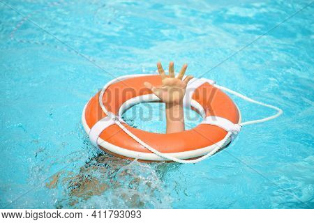 Drowning Kid. Helping Lifebuoy With Hands In The Water. Life Buoy Survive. Support Survival Or Save,