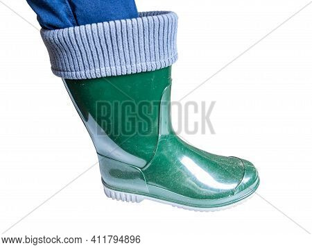 The Leg Of A Man In A Green Rubber Boot On A White Background. Human Leg. Rubber Boot. Rain Shoes. S