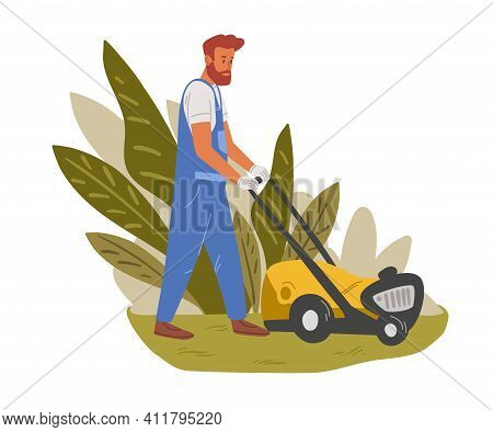 Garden Worker Mowing Lawn With Electric Push-mower In Backyard. Male Handyman Cutting Grass In Garde