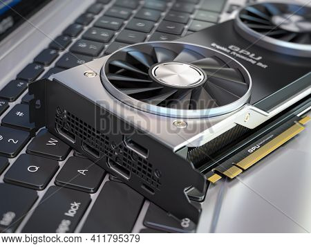 Graphics card on laptop keyboard. Modern gaming  GPU graphics processing units.  3d illustration