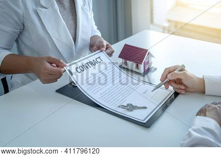 Hand Signing On Contract After The Real Estate Agent Explains The Business Contract, Rent, Purchase,