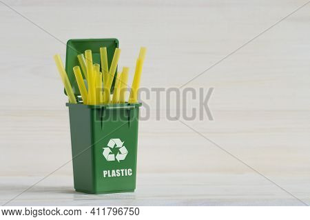 Green Container, For Sorting Garbage, With An Open Lid, Plastic Tubes, Ecology Icon, Close-up On A W