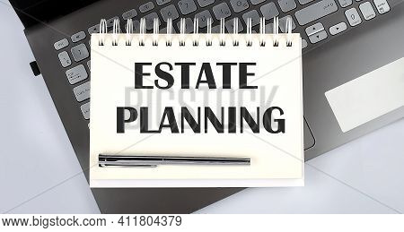 Business Concept - Top View Notebook Writing Estate Planning On The Laptop