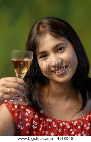 A Pretty Lady Saying Cheers For The Festive Season.