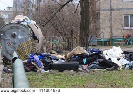 Kyiv Ukraine - March 05 2021:  Environmental Pollution. Garbage Dump On The Grass Near A Multi-store