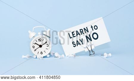Learn To Say No - Concept Of Text On Business Card. Closeup Of A Personal Agenda On Blue Background