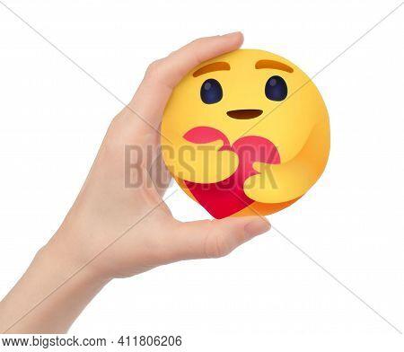 Kiev, Ukraine - February 17, 2021: Hand Holding Facebook Like Button Empathetic Emoji Reaction Of Ca