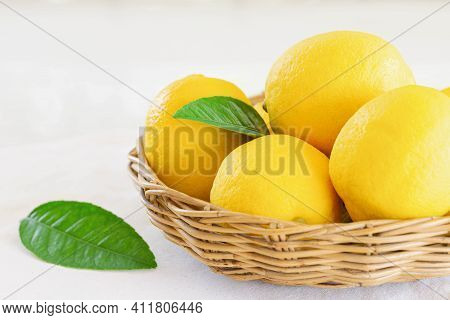 Group Of Whole Organic Lemon In Wood Basket On White Background. Fresh Lemon Have High Vitamin C And