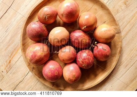 Fresh Passion Fruit In Wood Bowl On Wood Table In Top View Flat Lay With Copy Space For Background O