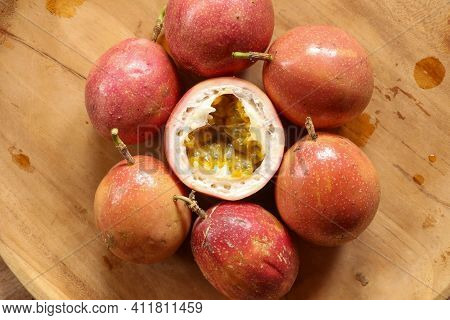 Passion Fruits On Wooden Background. Fresh Passion Fruits-healthy Fruit And Special Taste