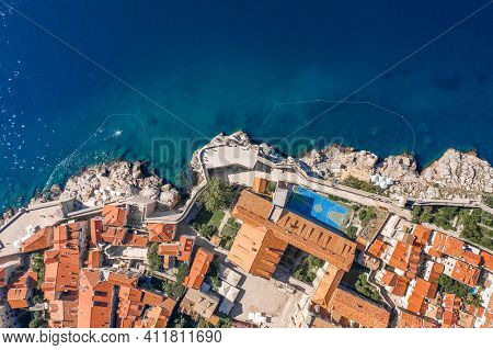 Aerial Overhead View Of Basketball Court By Crkva Sv. Margarite Church By Adriatic Sea In Croatia Su