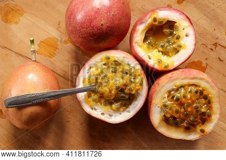 Passion Fruit Pulp With Spoon. Passion Fruits Juice On Wooden Background