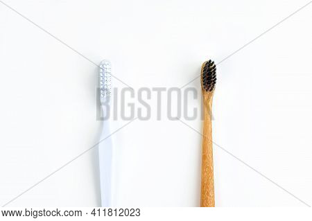 Bamboo Toothbrush Vs Plastic Toothbrush Concept. Toothbrushes Isolated On White Background. Save The