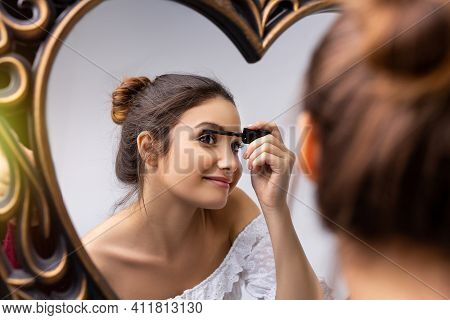 Woman Applying Makeup Beauty Product, Putting Makeup Mascara In The Mirror, At Home, Morning Routine