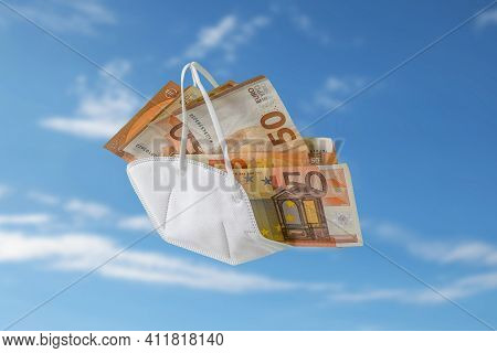 Medical Ffp2 Face Mask Against Covid-19 Filled Like A Bag With Euro Banknotes, Concept For Enrichmen