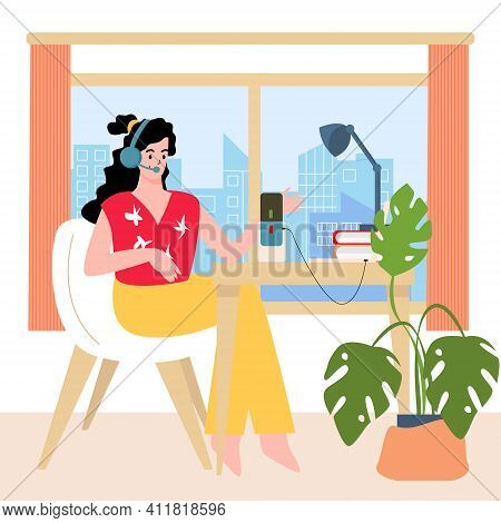 The Girl Is Sitting At Home In The Background Of The City With Headphones And Records A Podcast, Aud