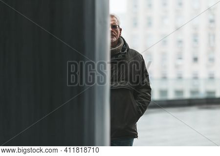 Depression And Split Personality. Half Portrait Of An Older Man, Divided Into White And Black. Psych