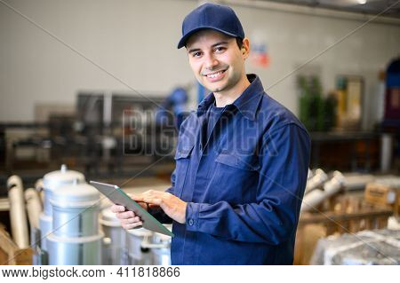 Portrait af an engineer using a tablet in a facility