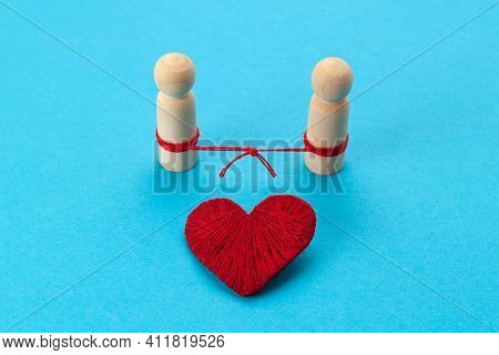 Connected Figures Of People And A Red Heart On A Blue Background. Restoring Broken Relationships. Su
